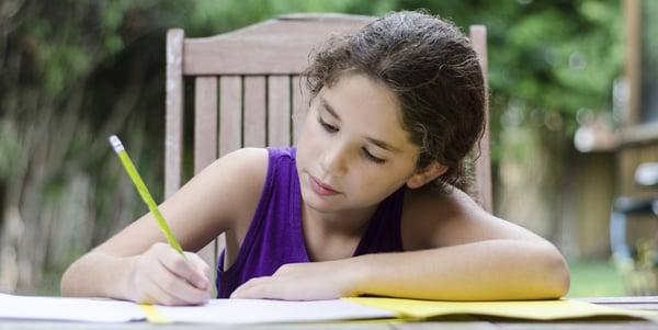 Girl doing homework outside