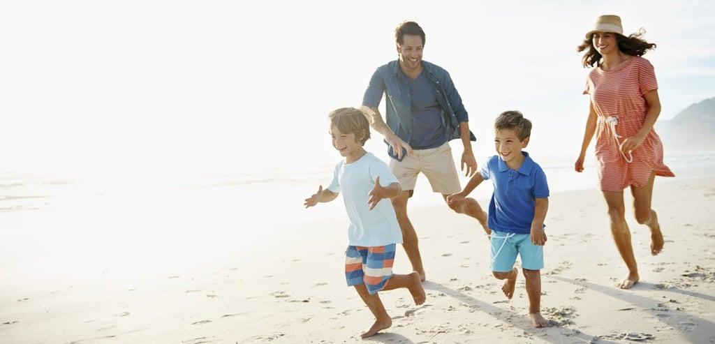 Family-running-on-beach