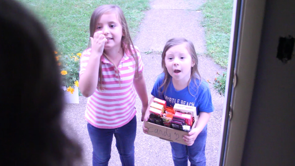 Kids selling candy door to door for a fundraiser