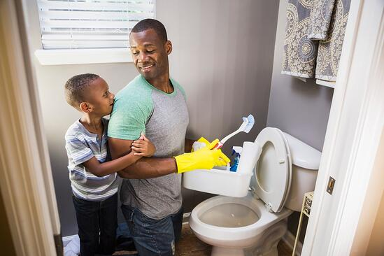 Father and son cleaning the bathroom