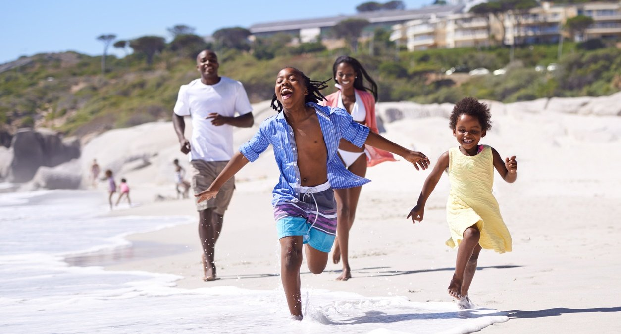 family_running_on_beach