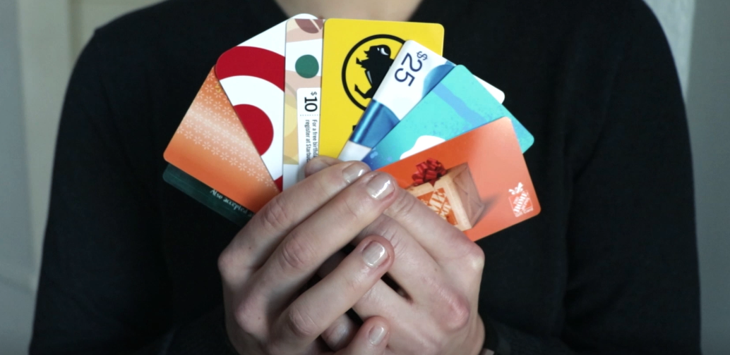 Person_holding_fan_of_fundraising_gift_cards