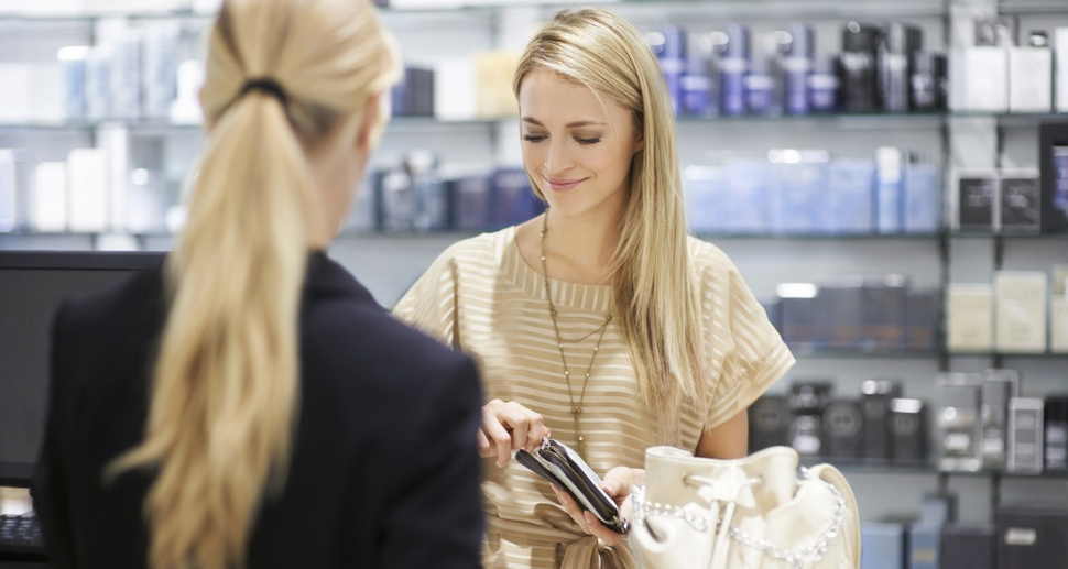 Woman at the store unzipping her wallet