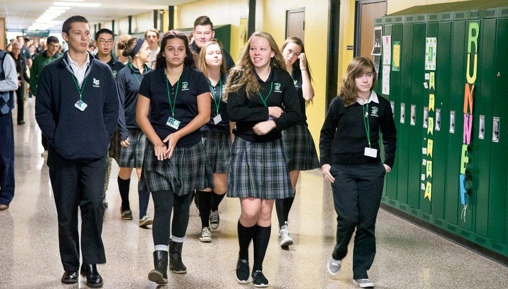Lumen_Christi_Students_walking_the_halls