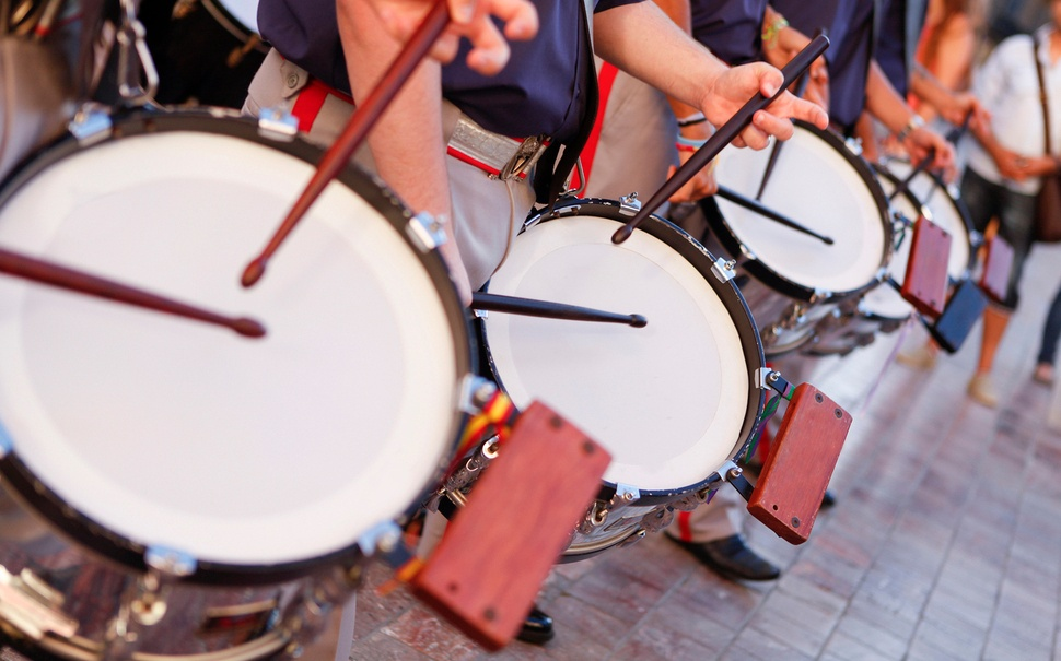 drummers marching in a street