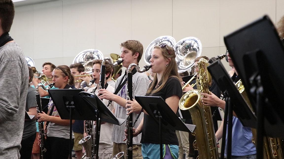 students_playing_instruments_at_rehearsal.jpg