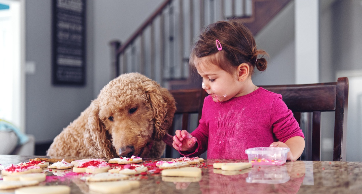little_girl_and_dog_decorating_cookies.jpg