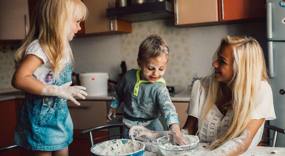 Kids in the kitchen baking cookies with their mom