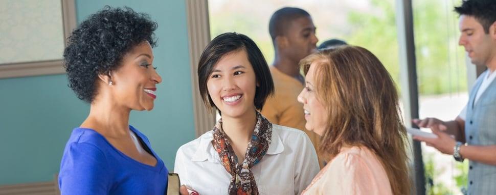 women talking in church lobby