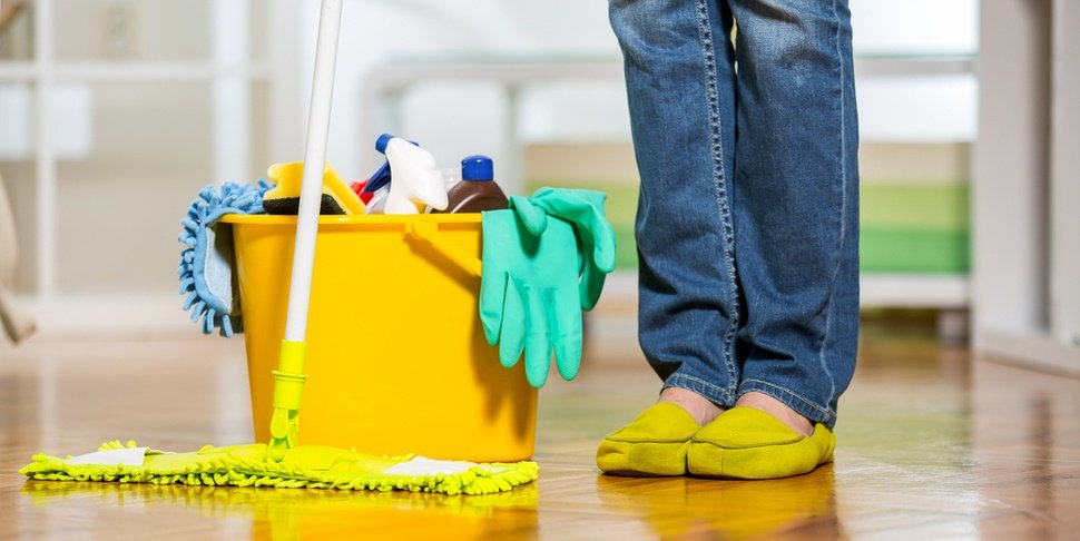 bucket-of-cleaning-supplies-and-woman-standing-by-it.jpg