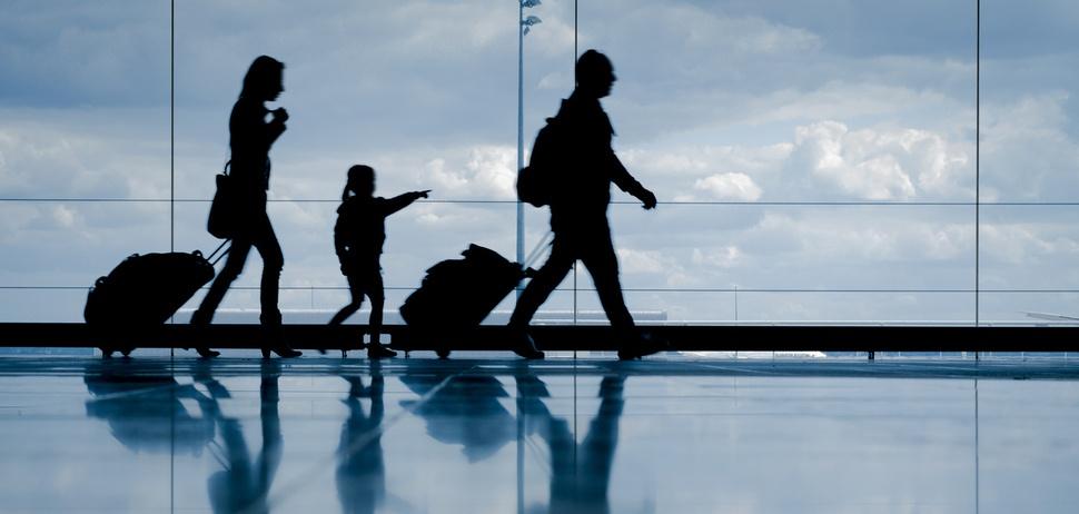 family-walking-through-airport