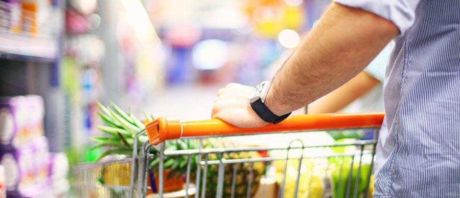 Man pushing a grocery cart