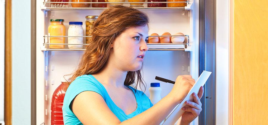 Woman writing grocery list
