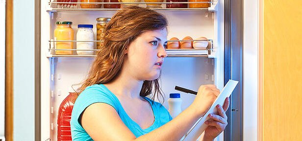 Woman writing grocery list