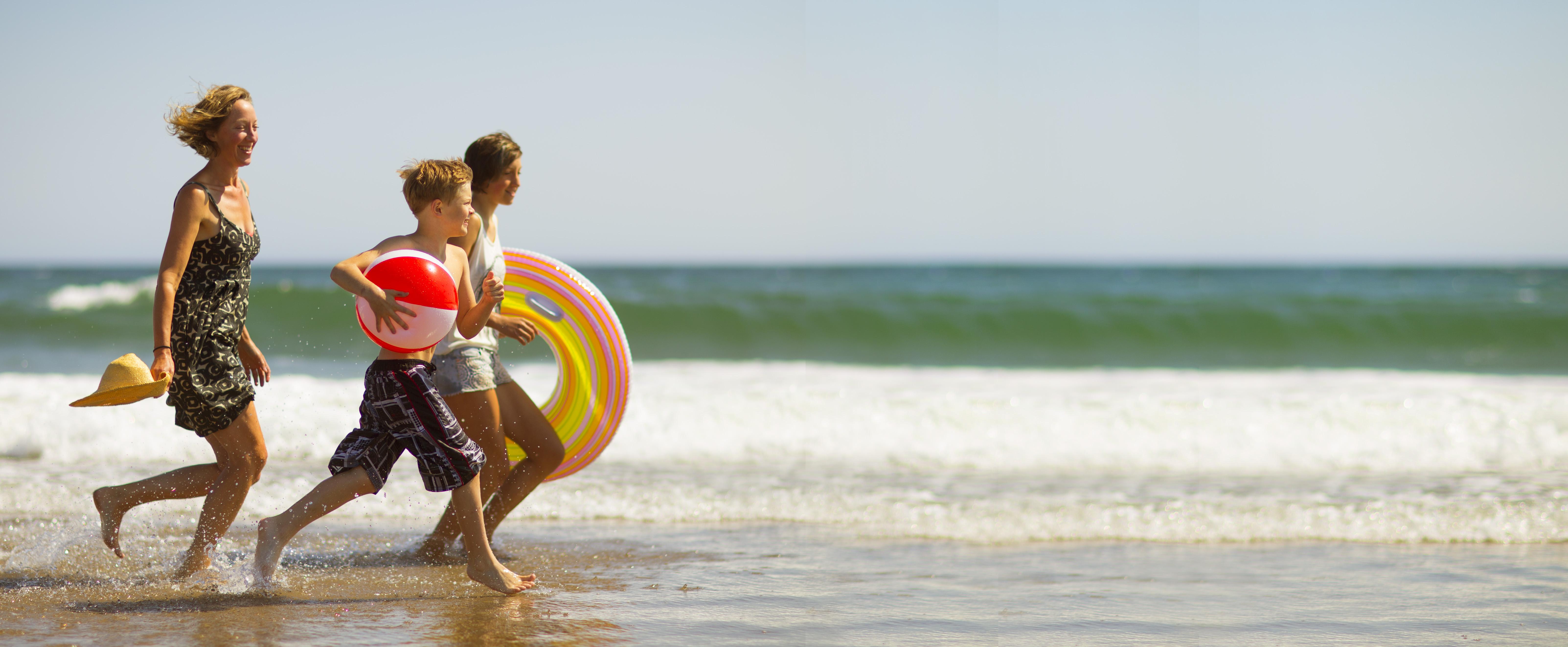 family_running_on_beach