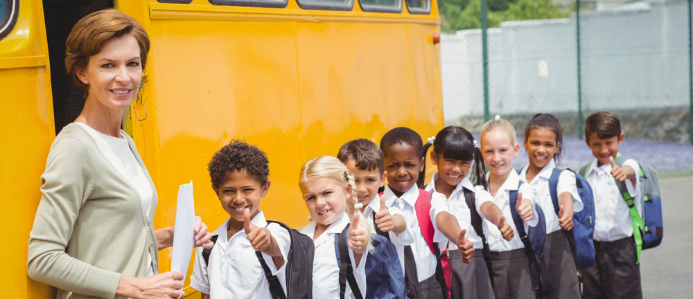 Parochial school students waiting for the bus