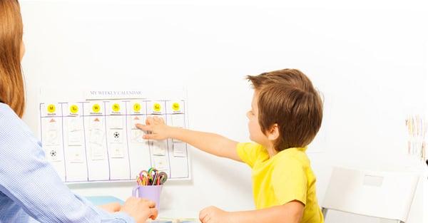 Boy going over his calendar