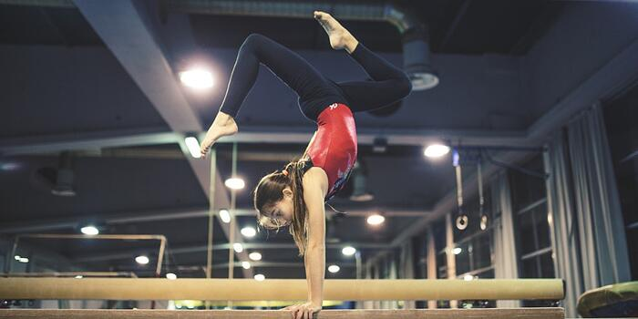 girl-practicing-gymnastics-picture-id654964272