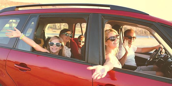 happy-smiling-family-with-daughters-in-the-car-with-sea-background-picture-id1217773190