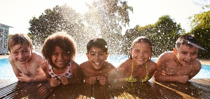 Kids_smiling_at_poolside.jpg