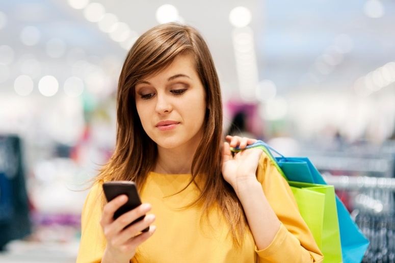 Woman on mobile device while shopping