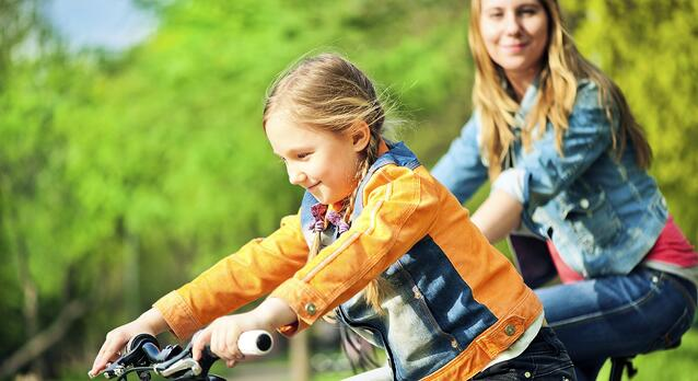 girl and mom riding bikes