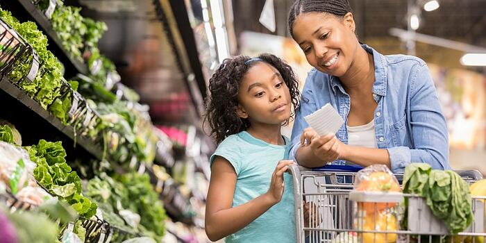 mother-and-daughter-grocery-shop-together-using-list-picture-id936496982