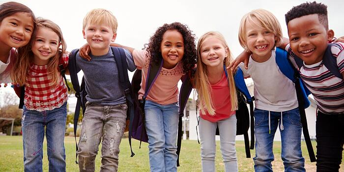 portrait-of-excited-elementary-school-pupils-on-playing-field-at-picture-id1160932512