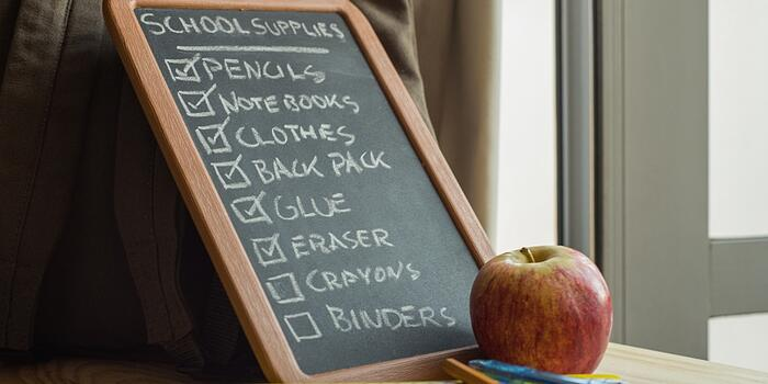 school-supply-list-with-school-supplies-and-an-apple-picture-id467579581