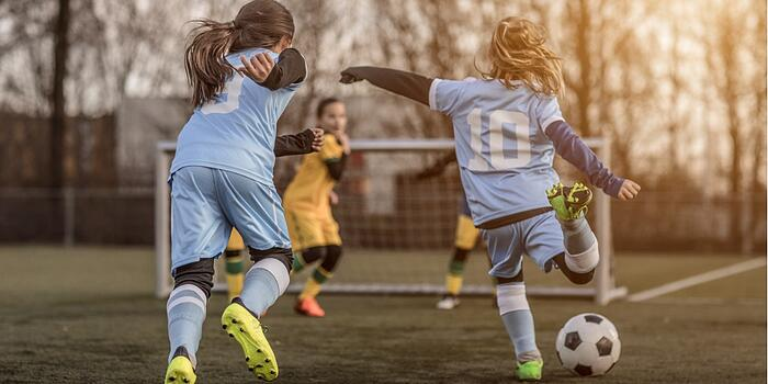 two-female-girl-soccer-teams-playing-a-football-training-match-in-the-picture-id923185900
